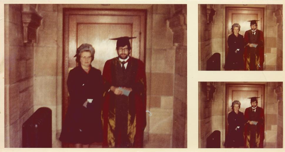 Myron posing in his PhD gown alongside his mother.